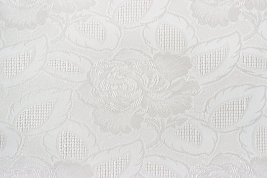 Close up of a white fabrics with floral pattern