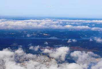 An airplane of Turkish Airlines fly over clouds after takes off from Istanbul New Airport