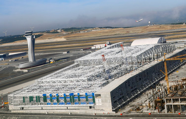 The control tower with new construction buildings are seen through the window of an airplane of Turkish Airlines at the new Istanbul Airport