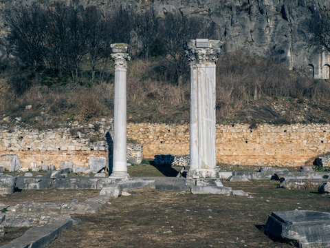 Two ancient Greek columns still standing among the ancient ruins of Philippi - Greece