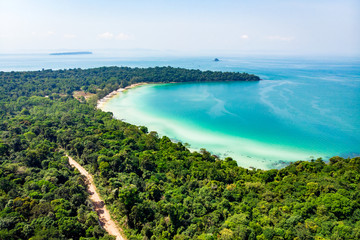 Top view of a beautiful tropical island with dense forest or jungle. long beach in tropical paradise snake island near sihanoukville cambodia Fototapete