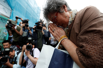 A local resident prays to mourn victims at the site where a stabbing occured in Kawasaki city