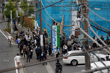 Members of the media gather at the site where a stabbing incident occured in Kawasaki city