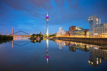 Fototapete - Dusseldorf, Germany. Cityscape image of Düsseldorf, Germany with the Media Harbour and reflection of the city in the Rhine river, during twilight blue hour.