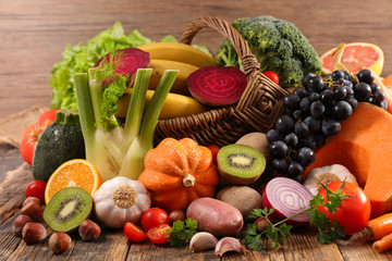 fruit and vegetable on wood background