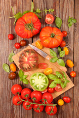 colorful tomato and basil with board and knife