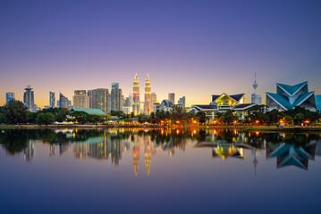 Wall Murals Kuala Lumpur Skyline of Kuala Lumpur by the lake at dusk