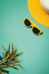 Straw hat and sunglasses in summer holiday concept