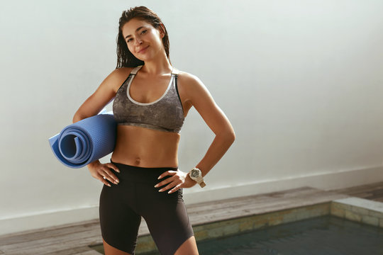 Woman in sports clothes after fitness workout outdoors