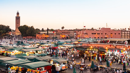 MARRAKECH, MOROCCO - MAY 15 2019: Djemaa El-fna at Marrakech, Morocco. Top view of the UNESCO square on ramadan kareem on sunset