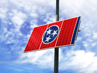 Solar panels against a blue sky with a picture of the flag State of Tennessee