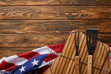 top view of crumpled american flag and bbq equipment on wooden rustic table with copy space Wall mural