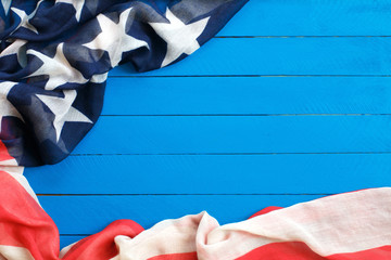 American flag on blue wooden background.The Flag Of The United States Of America. The place to advertise, template.