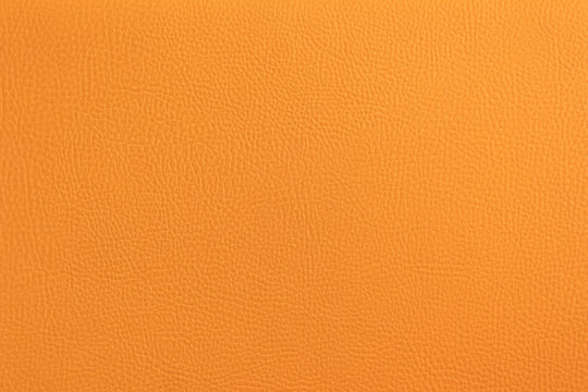 The original texture of the skin. Furniture upholstery orange, close-up