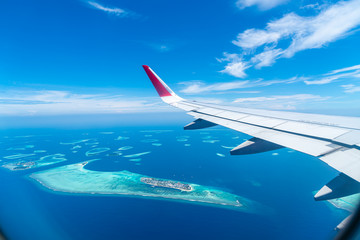 Maldives islands top view from airplane window Wall mural