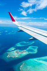 Keuken foto achterwand Vliegtuig Maldives islands top view from airplane window