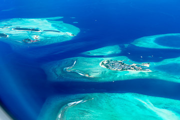 Maldives islands top view from airplane window