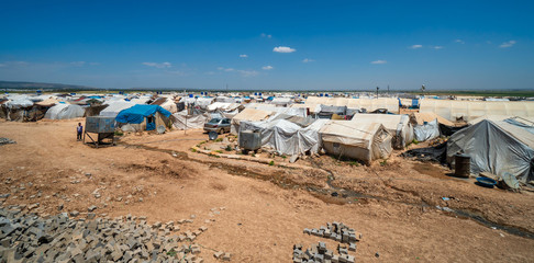 AZEZ, SYRIA – MAY 19: Refugee camp for syrian people in Burseya hill on May 19, 2019 in Azez, Syria. In the civil war that began in Syria in 2011, 12 million people were displaced.