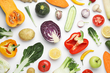 Flat lay composition with fresh ripe vegetables and fruits on white background
