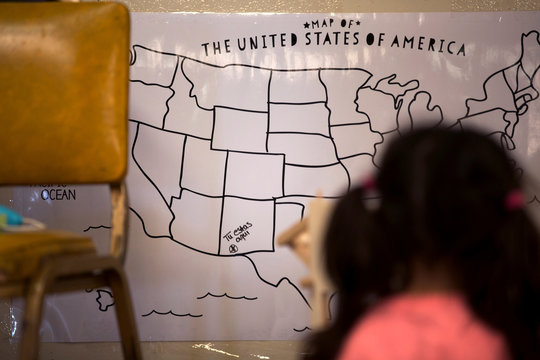 A map showing the location of the migrant shelter hangs on the wall inside the shelter at the Southwestern New Mexico State Fairgrounds in Deming