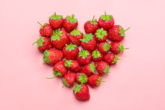 Heart made from deluxe, natural organic red juicy strawberry on a trend pink millennial background  Top View Flat Lay. Rustic Style Country Village Agriculture concepts