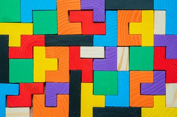 Tetris toy wooden blocks closeup Wall mural