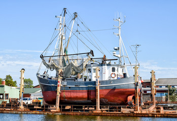 Fishing boat in a shipyard in Büsum on the North Sea in Germany