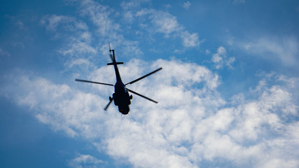 helicopter over autumn sky