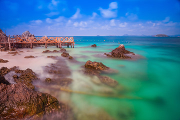 Koh kham island and wood bridge with blue sky and clear water at Chonburi Thailand.