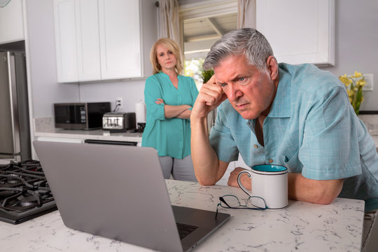 Older senior married couple in distress, concerned over mortgage, finances, financial earnings, debt