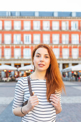 Spain, Madrid, Plaza Mayor, portrait of redheaded young woman with nose piercing