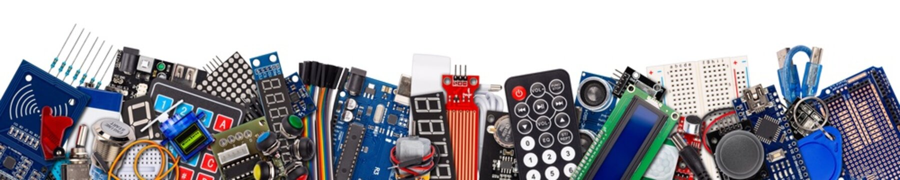 wide panorama banner collage with copy space of microcontroller board display sensor button switches cable wire accessories and equipment electronics concept panorama isolated white background