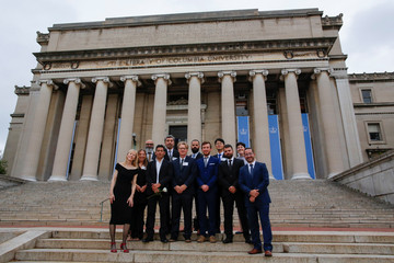 Reuters Pulitzer winners for Breaking News Photography Nicholson, Daut, Latif, Barria, Garrido, Blake, Garcia Rawlins,  Elliott, Kyung-Hoon, Konstantinidis, Perkins, Marcelino pose for a picture outside the Low Library at Columbia University in New York