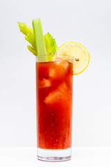 freshly made Bloody Mary cocktail or tomato juice, garnished with celery and lemon