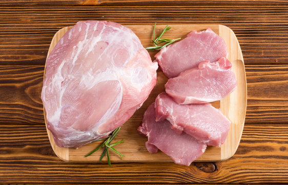 Raw pork meat on wooden background