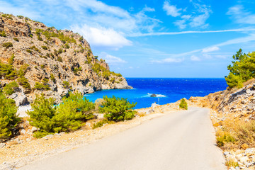 Fototapete - Road to idyllic Achata beach and azure sea, Karpathos island, Greece