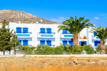 Fototapete - White Greek typical apartments and palm trees, Karpathos island, Greece