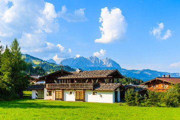 Wall Mural - Typical alpine house in countryside landscape near Kitzbuhel town, Tirol, Austria