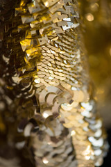 Macro abstract close up of golden sequins