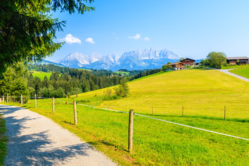 Wall Mural - Road in mountains near Kitzbuhel town and view of alpine houses on hill, Tirol, Austria