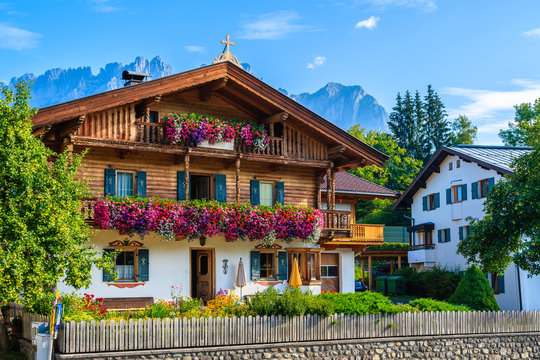 Traditional alpine houses in village of Going am Wilden Kaiser on beautiful sunny summer day, Tirol, Austria