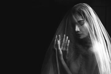 nude portrait of Asian model in dark tone
