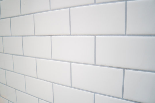 White subway tile with gray grout .