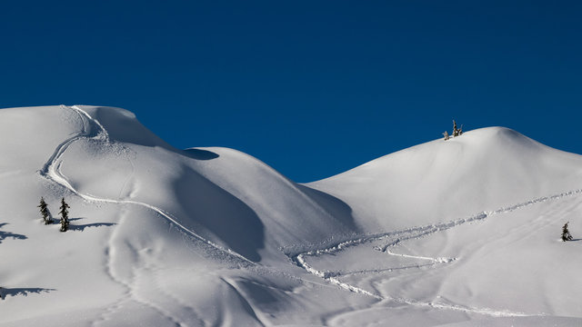 Tracks in the snow on a mountain top