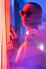 Woman under neon light