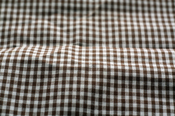 Checked fabric texture in blur effect.