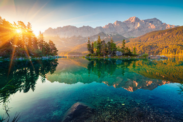 Spoed Fotobehang Nachtblauw Impressive summer sunrise on Eibsee lake with Zugspitze mountain range. Sunny outdoor scene in German Alps, Bavaria, Germany, Europe. Beauty of nature concept background.