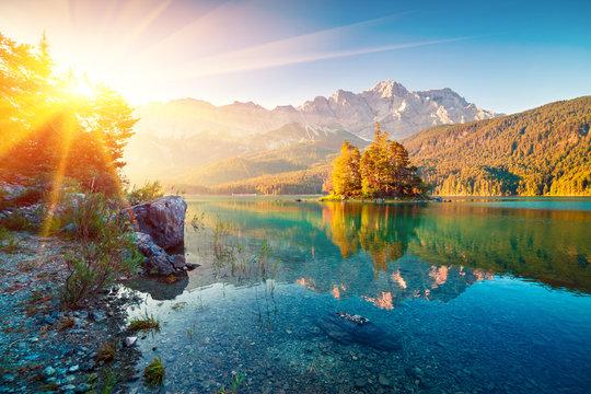 Picturesque summer view of Eibsee lake with Zugspitze mountain range. Sunny outdoor scene in German Alps, Bavaria, Garmisch-Partenkirchen village location, Germany, Europe.