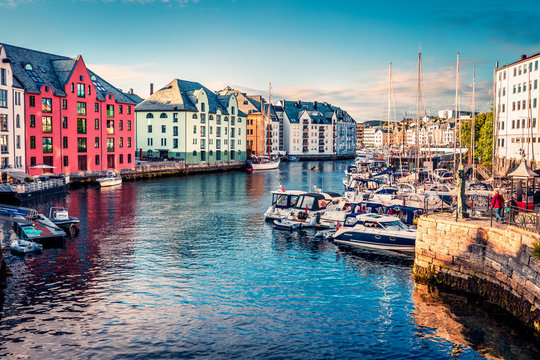 Great summer view of Alesund port town on the west coast of Norway, at the entrance to the Geirangerfjord. Colorful morning cityscape. Traveling concept background.