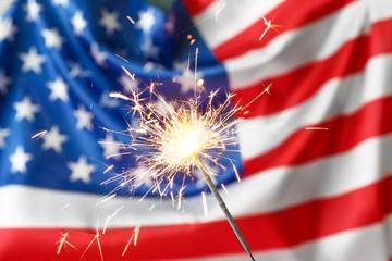 Canvas Prints Textures Sparkler against USA flag. Independence Day celebration